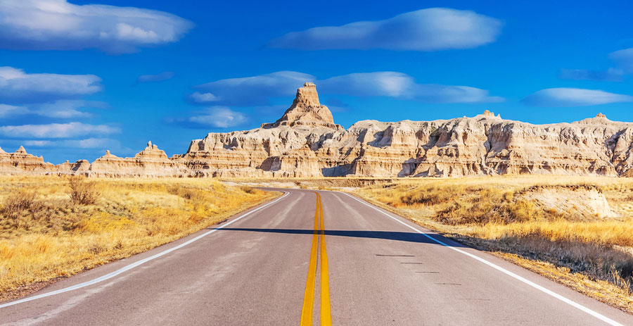 The Badlands Loop Road in South Dakota and a clear blue sky