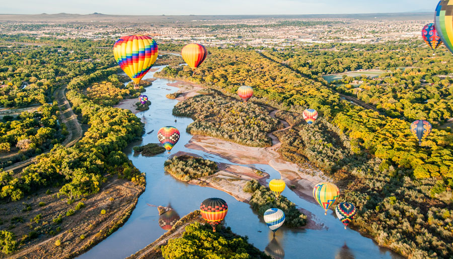 View of colorful hot air balloons over the Rio Grande