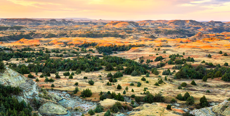 View of sunrise over Theodore Roosevelt National Park